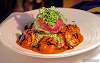 The Camarones en Tequila is a flavorful gluten-free item on the San Angel Inn menu that places Tequila flamed Shrimp a la Diabla around a pile of Poblano rice (and a bit of cilantro), which then gets a coating of a cascabel pepper sauce and then drizzled with a tamarind glaze. A grilled stack of seasonal vegetables is placed on top.