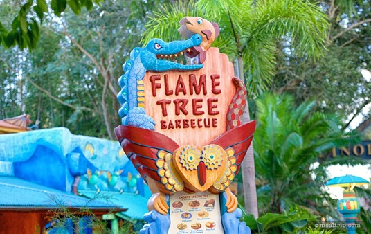 This sign in front of the Flame Tree Barbecue also serves as a two-sided menu board.