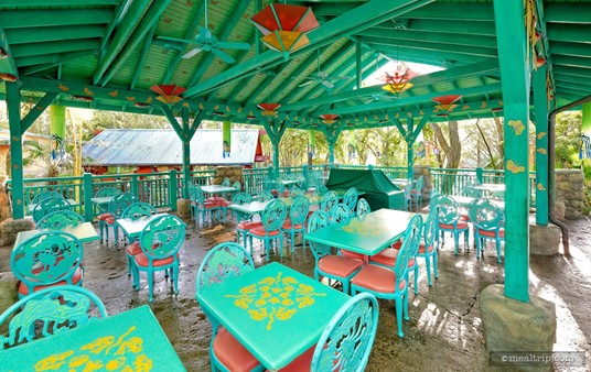 Flame Tree BBQ has many outdoor seating areas. Some, like the green 