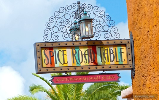 The Spice Road Table sign hangs over the entrance of this restaurant in the Moroccan pavilion at Epcot.