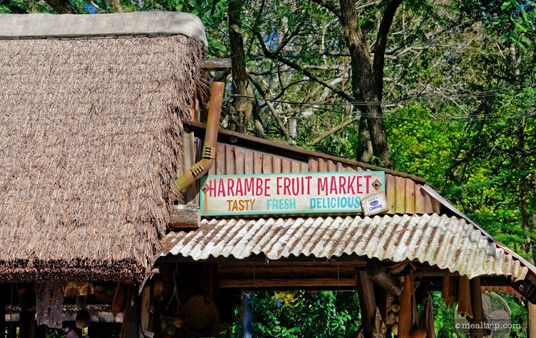The very detailed sign and straw roof above the Harambe Fruit Market.
