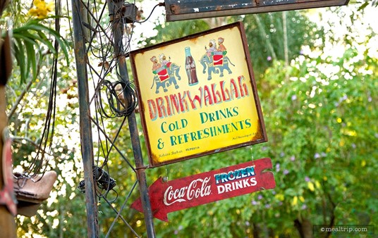Street-side sign for Drinkwallah, one of the more immersing, detailed... soda stands.