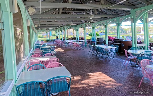 A fully covered seating area wraps around both sides and behind Mango Joe's.