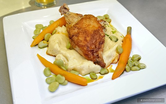 From the Land section of the menu, the Stuffed Chicken entree. The chicken is stuffed with copped spinach, herbs, and cream cheese. The dish is accompanied with cheesy polenta and seasonal vegetables.