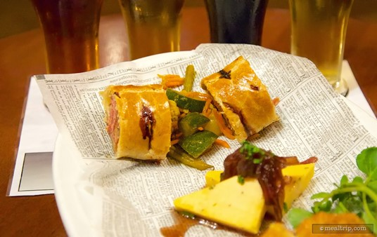 Pork and Apple Sausage Roll with House-made Piccalilli on the After Hours sampler plate.