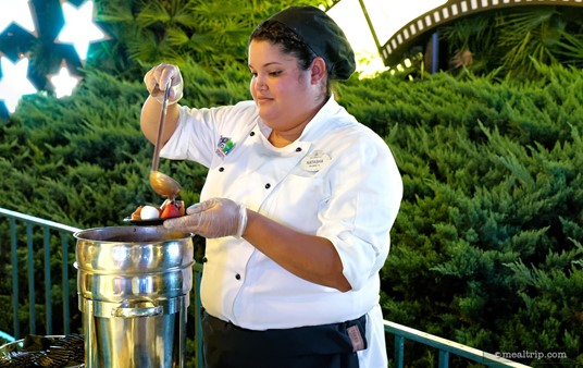 After you've made your selection of various fruits, pretzels and  marshmallows, a cast member will cover them with warm milk chocolate  fondue at the Frozen Dessert Party.