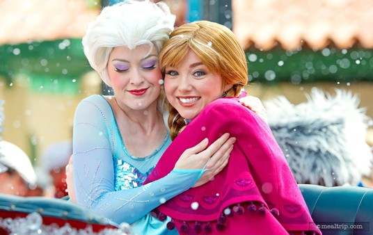 """The Frozen Dessert Party is part of the Frozen Summer Fun Premium Package and includes reserved  """"royal viewing"""" for the mini-parade earlier in the day. Here, Anna has  spotted my giant lens, while Elsa seems more interested in a hug."""