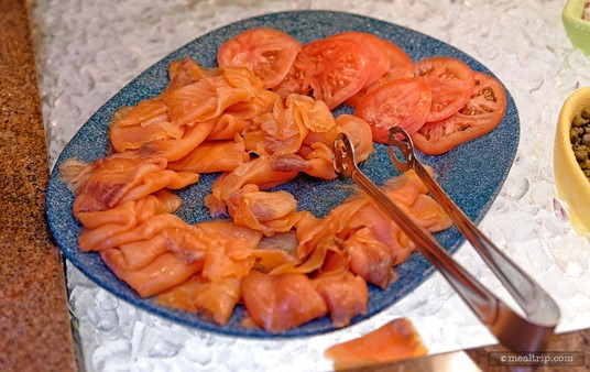 Smoked Salmon and Sliced Tomatoes are plated together. Capers, Onions and Bagels are also available.