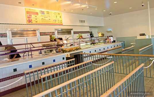 The food order and pickup line is located to the left of the main entrance.