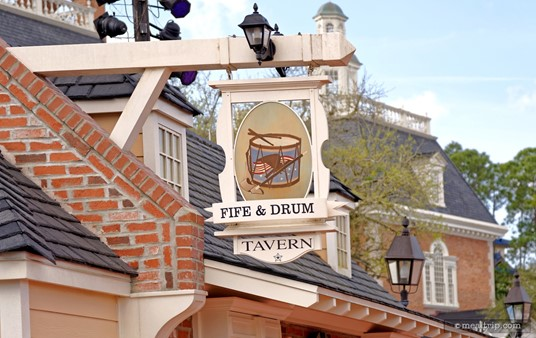"The Fife and Drum ""Tavern"" (in this case, is really a kiosk only, offering no actual tavern-style seating), sign hangs just above the location."