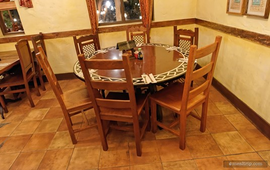 This round table for six might be a little tight for six actual people, but I could see five sitting here comfortably.