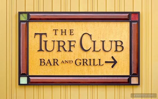 The Turf Club Bar and Grill sign, found in an interior hallway at Disney's Saratoga Springs Resort.