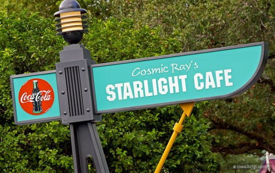 This Cosmic Ray's Starlight Cafe sign is across from the Tomorrowland Speedway and down by the Mad Tea Party attraction.