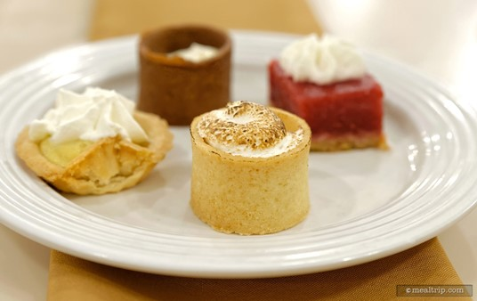 Front and center on this plate is a Banana Cream Pie (in a tiny edible cookie cup).