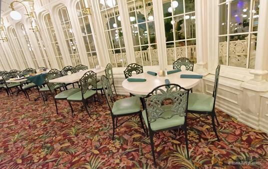 Here's a look at a table that's set, and ready for guests. Most of the tables at the Crystal Palace have wrought iron chairs, while a few offer partial bench style seating.