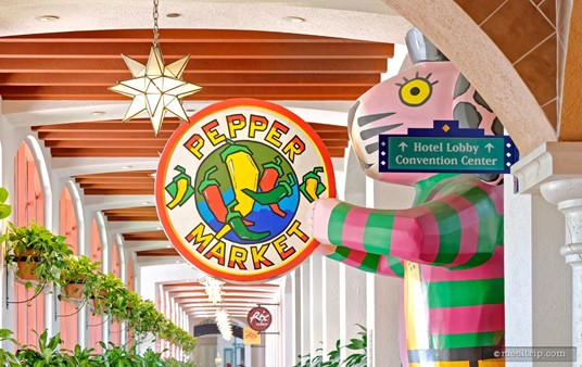 "A giant Oaxacan wood carving (well, it's not ""real"" wood) marks the entrance to the Pepper Market at Coronado Springs."