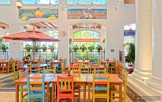 "The dining area at Pepper Market has very high ceilings and brightly colored chairs and tables giving the area a ""courtyard"" feel, while being completely indoors."