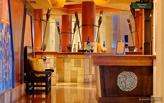 The check-in desk at Maya Grill is located in a long hallway, before you get into the main seating area.