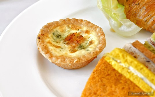 "A Smoked salmon quiche with spinach and dill was one of the items on the ""warm"" side of the plate on the second course at ""The Parisian Afternoon"" lunch event."