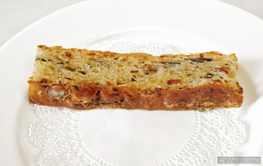 """An up-close shot of the Bacon Mushroom """"Toast"""". The fresh bread was more like a proper, dense Focacci, with the bacon and mushroom being baked into the bread and not just on top."""