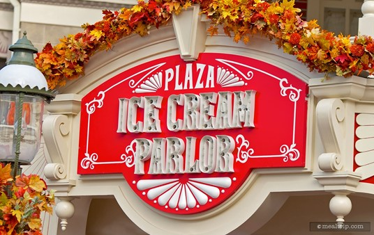 This Plaza Ice Cream Parlor sign is on the corner of the building and facing Cinderella Castle.