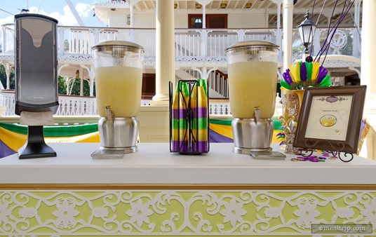 The Lemonade table at Tiana's Riverboat Party features some really cool colored plastic cups.