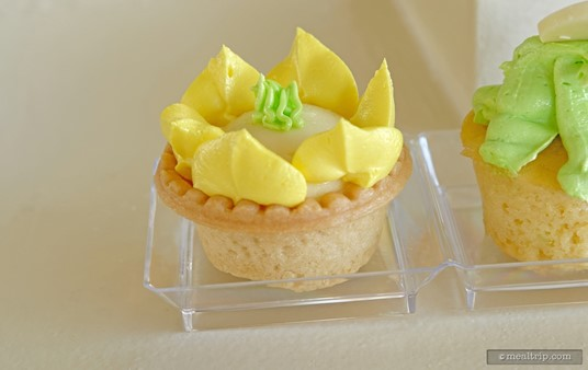 One of three pastry desserts at Tiana's Riverboat Party, a Cream Filled Tart Decorated with Yellow Buttercream Icing.