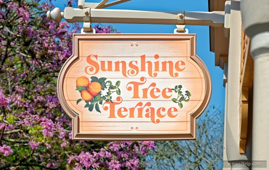 The Sunshine Tree Terrace Sign hangs over the building.