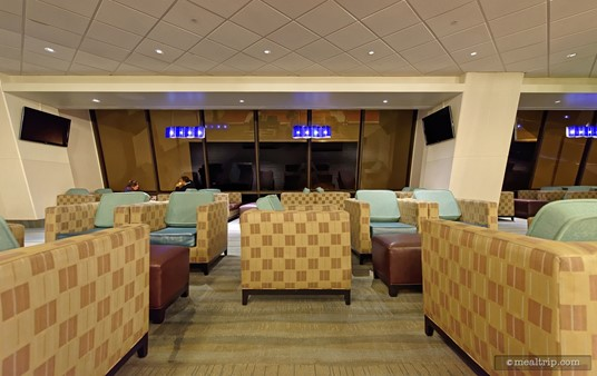 "Some of the coolest seating at the Outer Rim Lounge is provided by these very square chairs. They offer good views of the lake and pool area outside the giant windows. (Note, this is the ""wrong"" side of the Contemporary to see the castle.)"