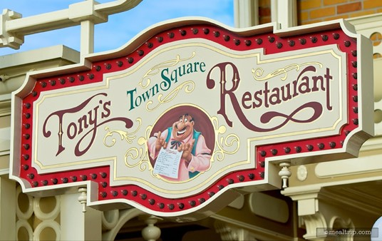 Tony's Town Square sign high above Main Street facing the City Hall building.