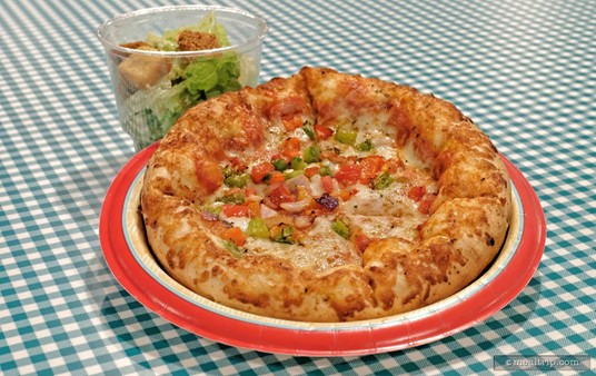 This is the Vegetable Pizza with the side Caesar Salad that is served with it. All pizza entrées are served with a side salad.