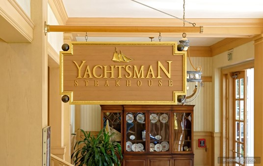 The Yachtsman Steakhouse sign hangs over the main entrance in a hallway of sorts.