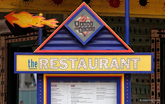 The House of Blues logo above an exterior menu board.
