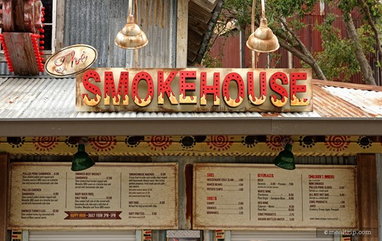 The Smokehouse sign above the menu board, which is above the order and pickup window!