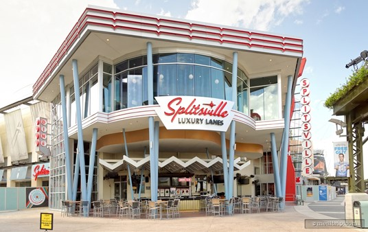 Here's a great look at the main entrance... and really, the whole building at Splitsville, in Disney Springs. There's an outdoor covered lounge area on the bottom floor, and an indoor air-conditioned dining area just above that on the second floor.
