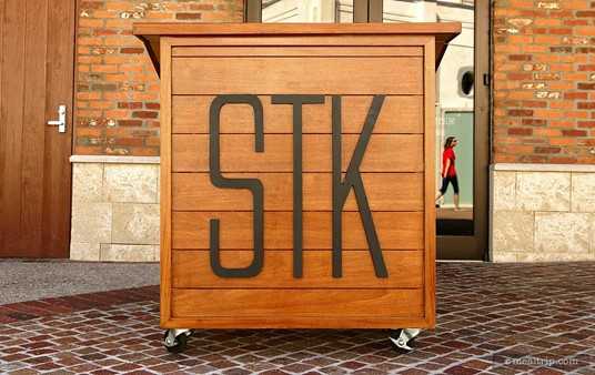 The outdoor host/check-in station at STK.