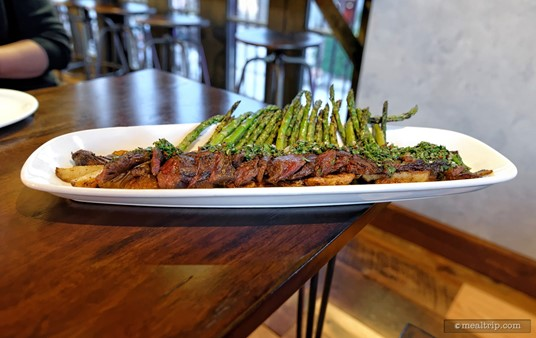"""The Skirt Steak at Wine Bar George is plated with Roasted Potatoes, Chimichurri, and """"seasonal vegetables"""" (which in this case, was asparagus)."""