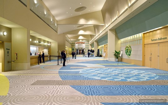 Looking east down the lobby hall of the Fantasia Ballroom event space. The check-in desks are on the left and the doors leading into the Countdown to Midnight New Year's Eve event are on the right.