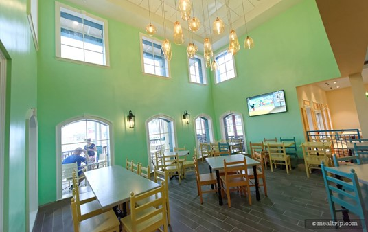 Some of the dining areas have a teal color system on the walls with white trim. It's a modern, tropical feel, that's very nicely done.
