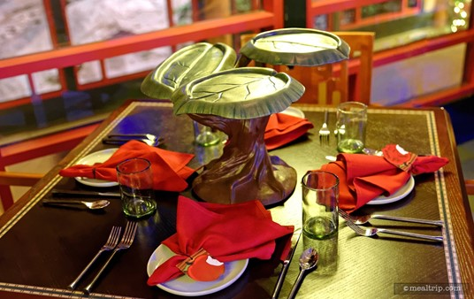 """A closer look at a four guest table setting. That """"spinning tree"""" does take up quite a bit of room on the table."""