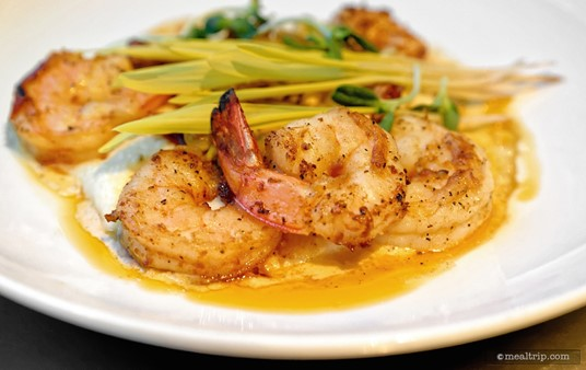 The Coral Reef's version of Shrimp and Grits included five Sauteed Shrimp that are plated on top of Cheddar Grits.