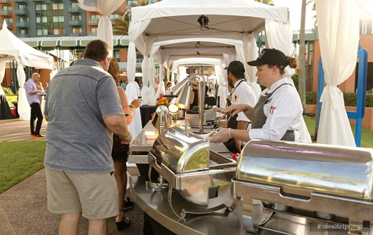 There are food and beverage stations on both sides of the main Causeway at the Swan and Dolphin Food and Wine Classic. (2018)
