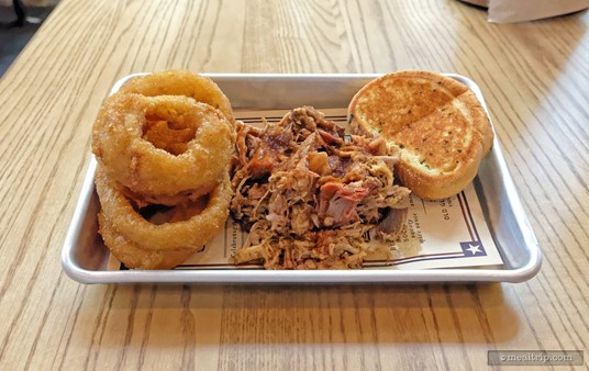 "The North Carolina Chopped Smoked Pork Butt Platter features chopped pork butt topped with North Carolina Vinegar Sauce and is served with Garlic Toast. Most of the entrees also come with a ""side item"". Pictured here, are the beer-battered onion rings."
