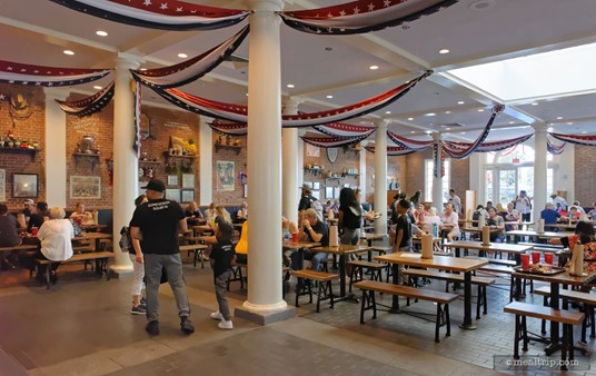 This is the main interior dining area at the Regal Eagle Smokehouse, looking north and west. The bench style seating offers no back support.
