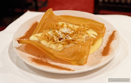 The unique Bastilla combines layers of phyllo dough, fried almonds and an orange custard cream anglaise, with a dusting cinnamon.