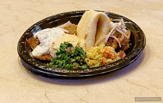 Shawarma Chicken and Lamb Platter - Served with a  side of Hummus, Tabouleh, and Tangierine Couscous Salad with fresh  Moroccan Bread.