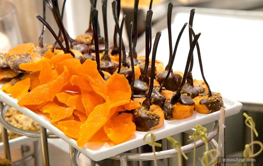 Chocolate dipped orange cakes and dried apricot slices.