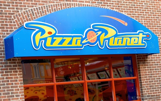 Pizza Planet Signage over one of the building's windows.
