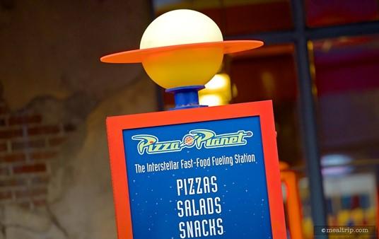 Small menu board outside Hollywood Studio's Pizza Planet.