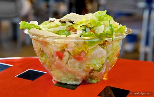 Greek Salad - Romaine, Tomato, Cucumber, Kalamata Olives, Red Onion, Feta Cheese, and Greek Dressing tossed-to-order.